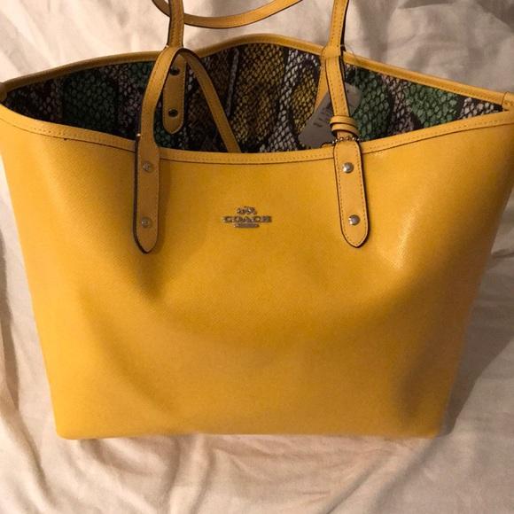 e28e6bbd4ed7 Mustard color NWT reversible coach bag